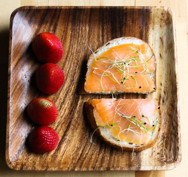 Cream Cheese and Salmon Sandwich with sprouts with Fresh Strawberries.