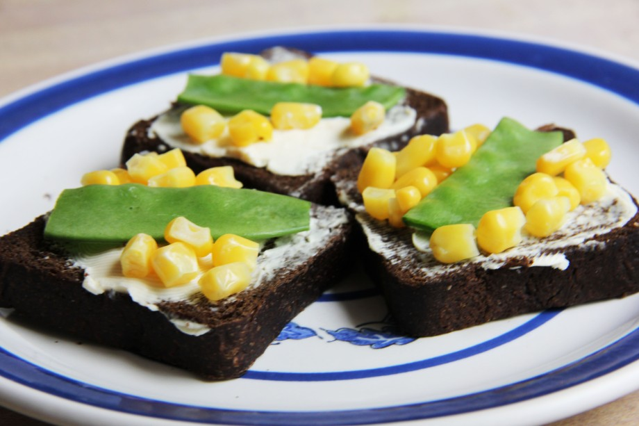 Pumpernickel Squares with Corn and Peas.